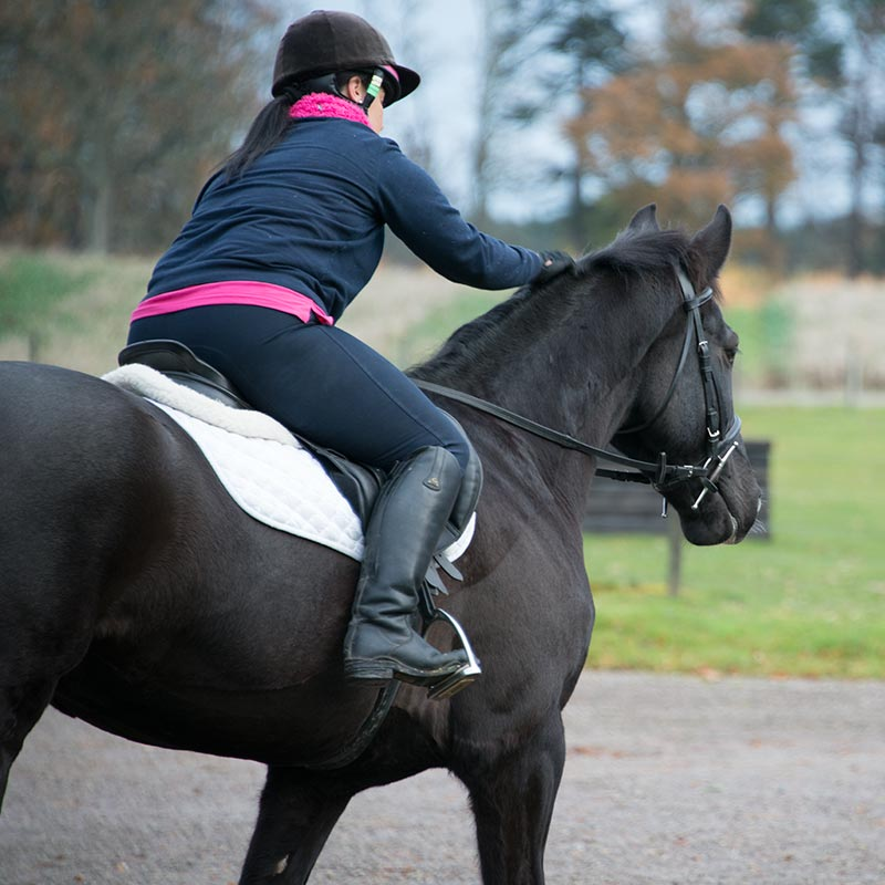stables manager Amanda Waugh riding a horse