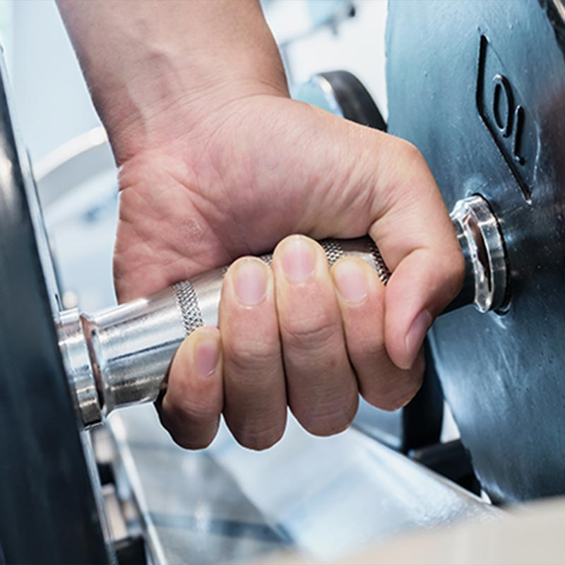 closeup of a hand holding a dumbbell