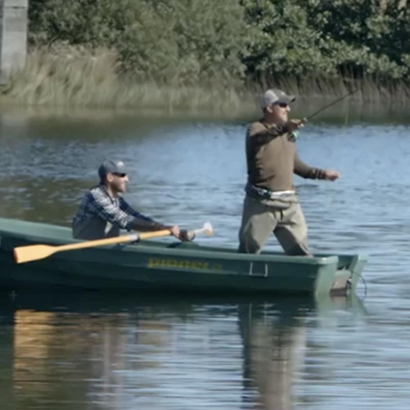 2 men fishing from a small boat
