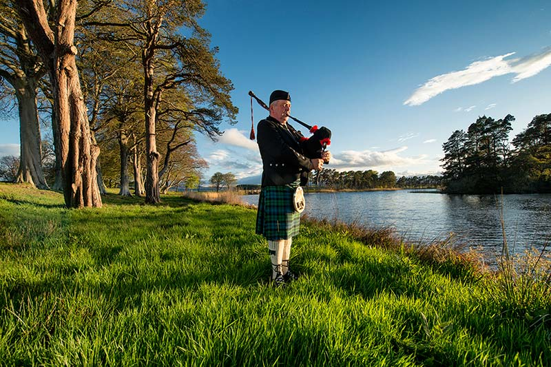 bagpiper Graham Grant by the water